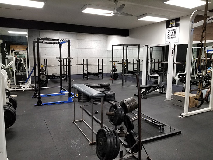 Our Vancouver Gym's Squat Racks and Weight Pads